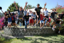 The young people leaping with joy on their weekend away