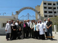 Staff outside the Al Ahli hospital