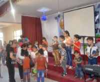 The displaced children enjoying the youth session and receiving gifts