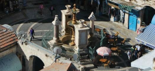 An ornate fountain in a Jerusalem courtyard