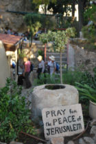 A sign saying Pray for the Peace of Jerusalem in the Garden Tomb