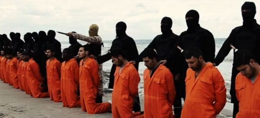 Isis line up Christians wearing orange jumpsuits, ready to be executed