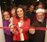 Yousra, Dr Mahmoud Azad, Sheikh Mohammed Gemeah and Bishop Mouneer all cutting the red ribbon to open the ceremony
