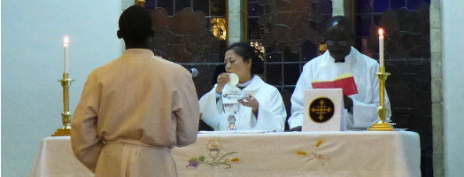 Shu Peijin leading the eucharist