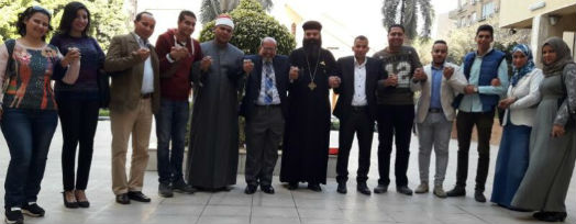 Muslim and Christian leaders and young people standing together holding hands